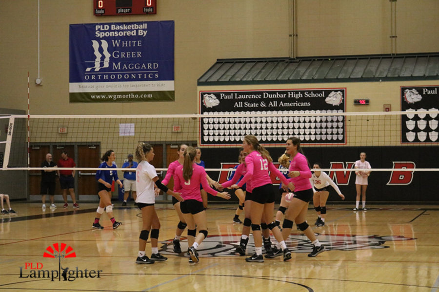 The team celebrates after getting the point.