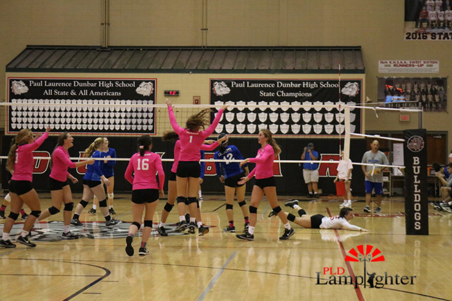 The Bulldogs celebrate as they seal the deal in the third set with a big block at the net.