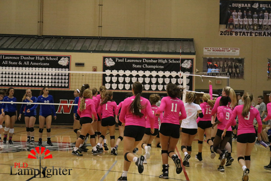 The Bulldogs hustle to the net after they beat Lafayette in three sets.