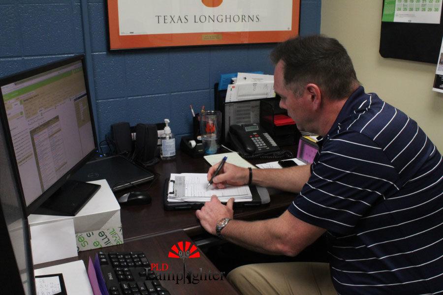 Mr. Keys working on a paper