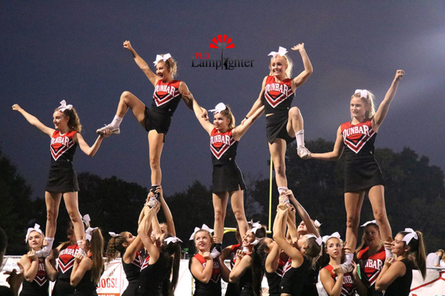 Dunbar cheerleaders lead the crowd in formation for the homecoming game.