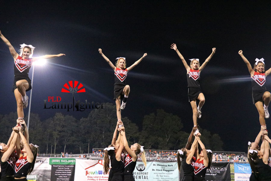 Dunbar cheerleaders performing a stunt for the crowd.