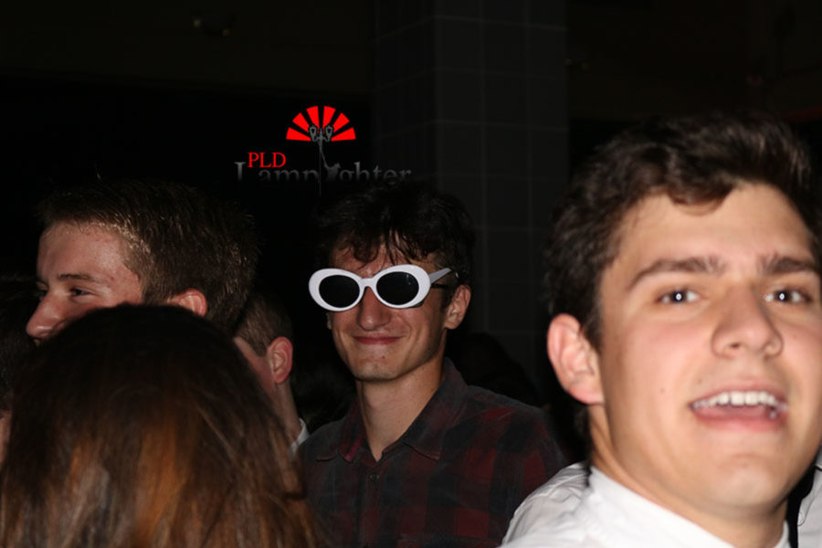 Senior Andres Gedaly smiles for the camera with his sunglasses on.