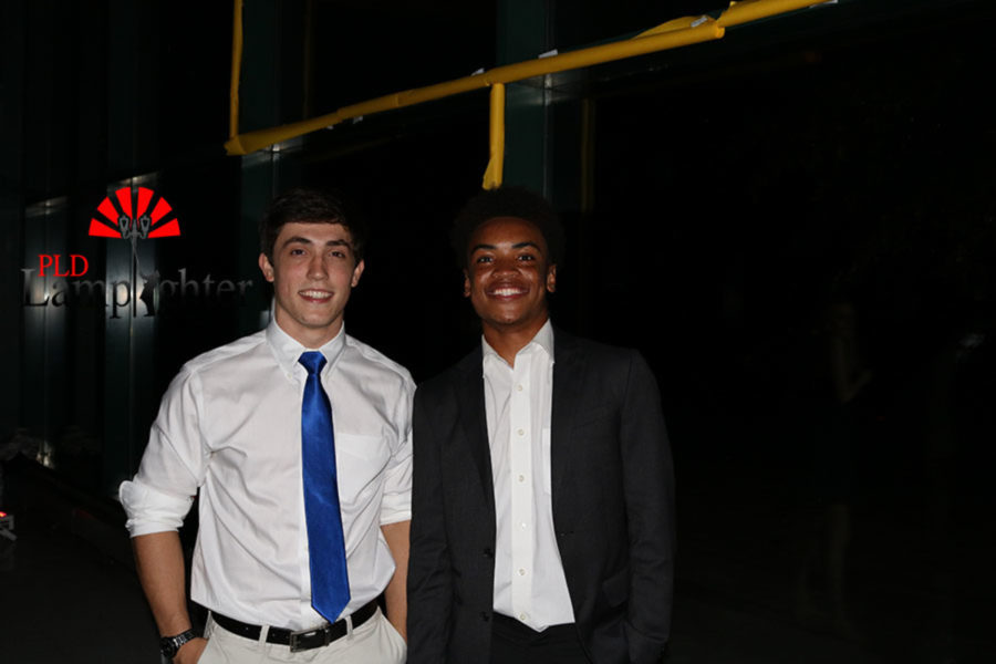 Senior Nathan Wilson and Junior J.T. Jett give their biggest smiles for the camera.