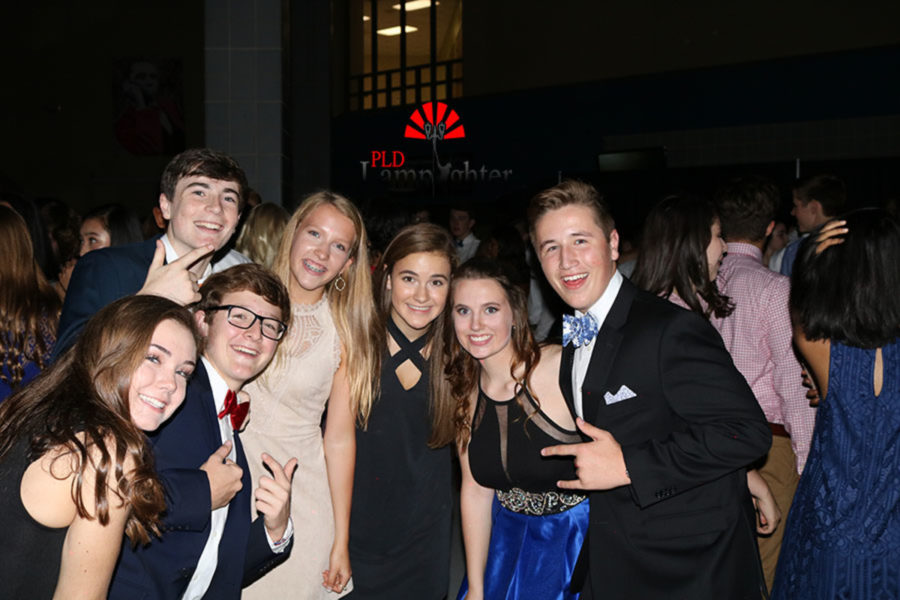 A group of sophomores poses and smile for the camera.