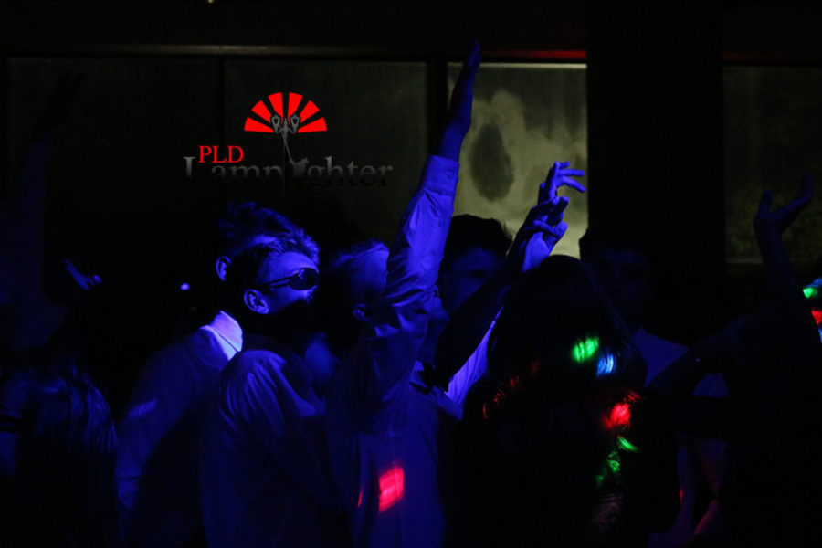 Dunbar students dance in the neon lights of homecoming.