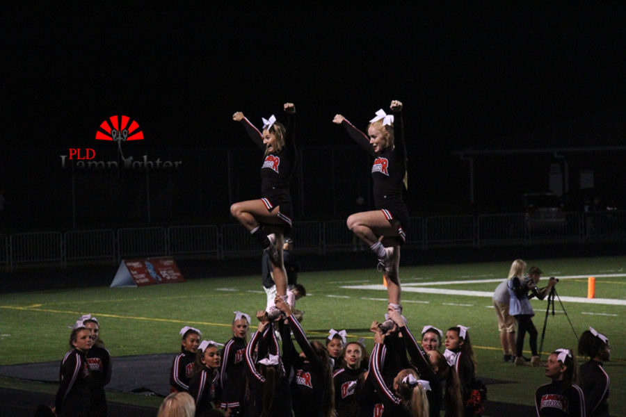 Cheerleaders Natalie Rowe (left) and Julia Beard (right) up in a stunt