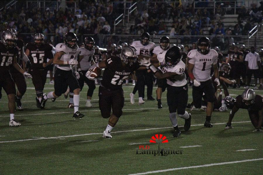 (#22) Senior Darren Edmond tries to tackle the runner.