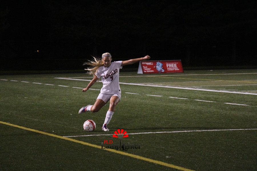 #3 Senior Callahan Stokley side kicks the ball back into the game.
