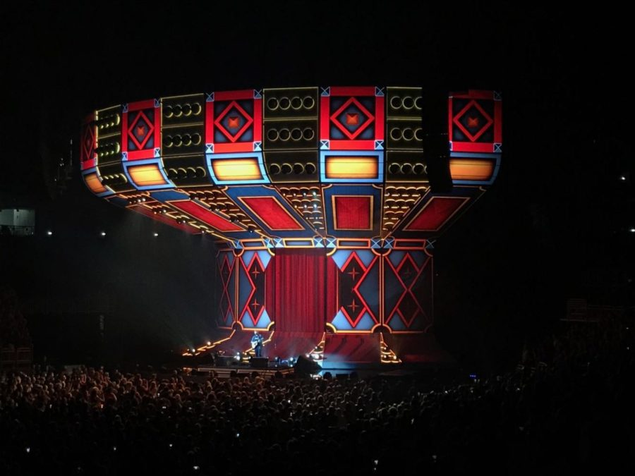 The jumbo screen portrays different scenes that relate to the song he performs.
