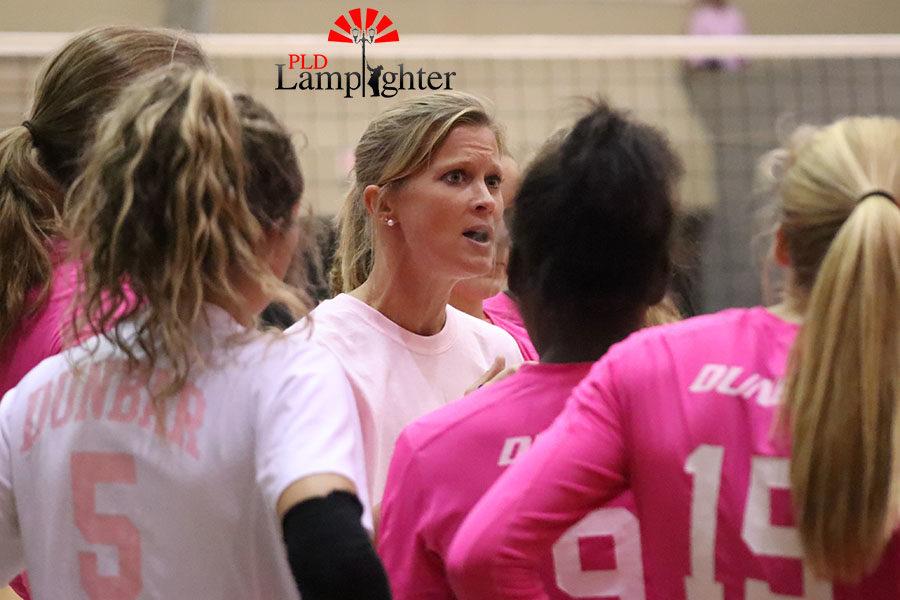 Volleyball coach Jennifer Morgan lectures her girls after winning a set.