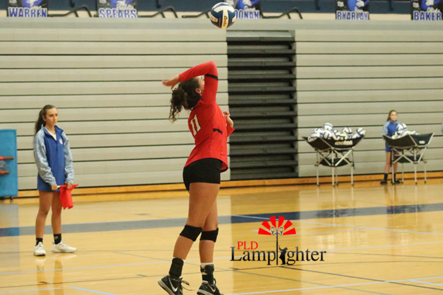 Senior Savannah Dudek goes after the ball to serve for an ace.