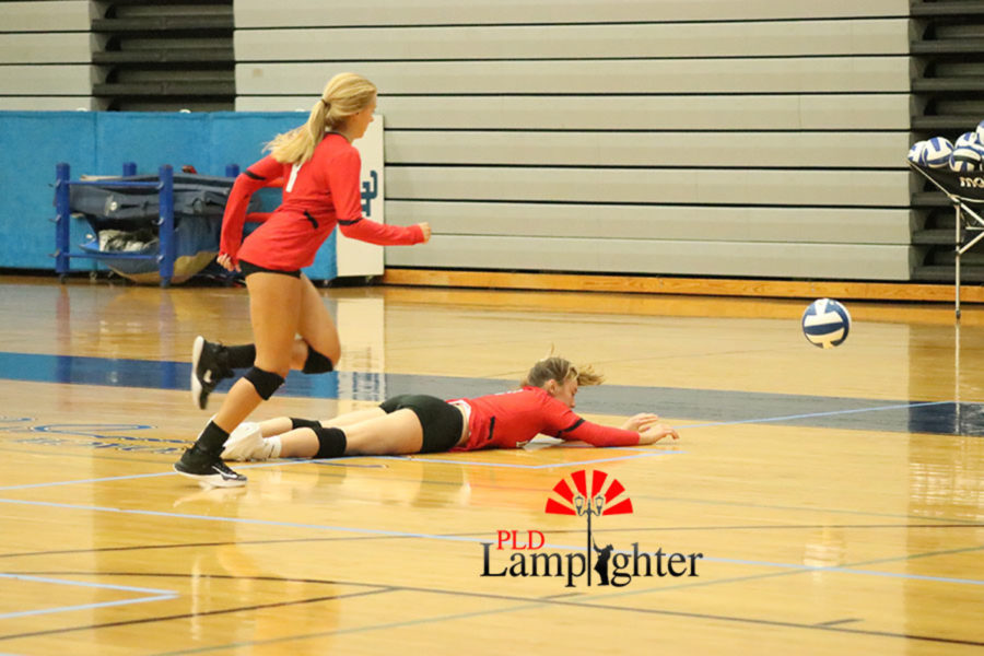 A great hustle play is made by Lauren Spanyer and Olivia Stotz.