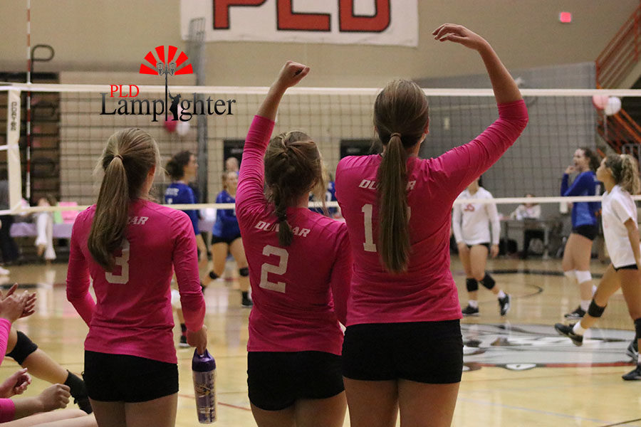 #3 Caroline Cole, #2 Lauren Spanyer, and #17 Virginia Smith excitedly cheer on their teammates.