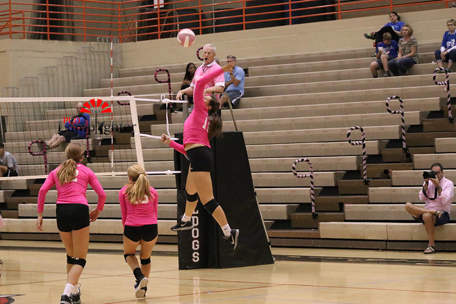 #19 Peyton Gash launching the ball over to the Lafayette side of the net.