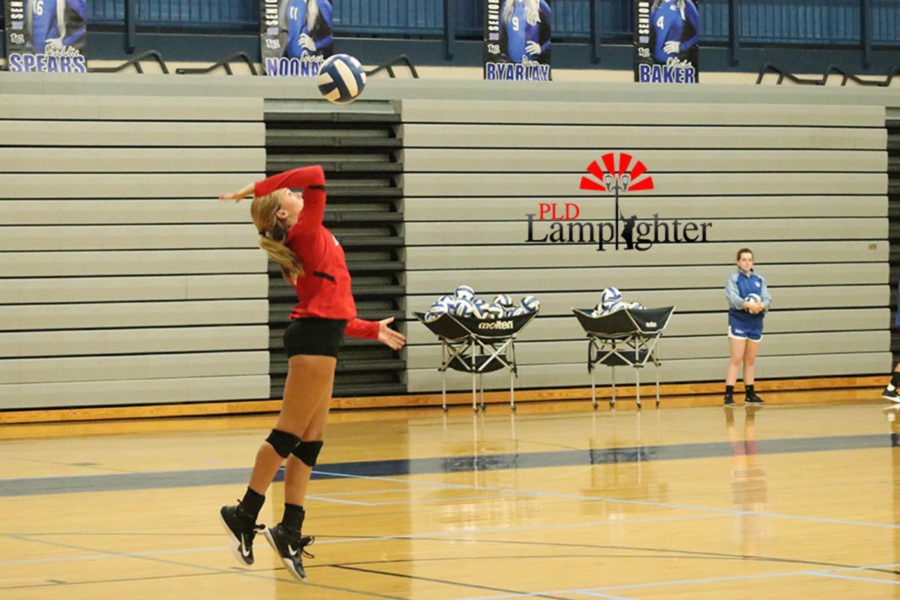 Olivia Stotz being aggressive from the serve line to ace out Lexington Catholic.