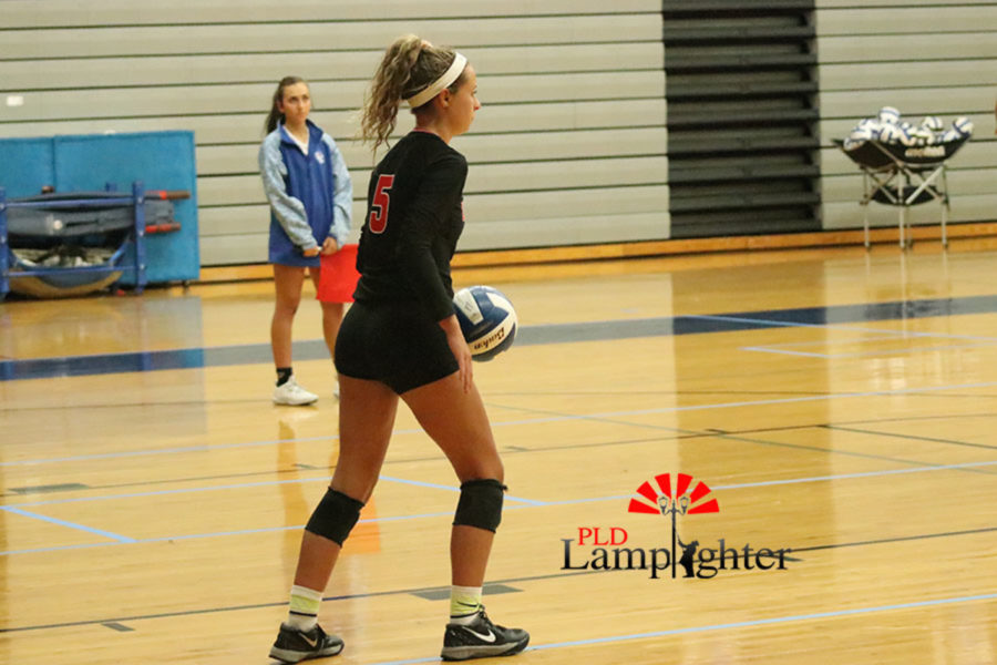 Senior libero, Allie Chapman, gets ready to serve in the first set.