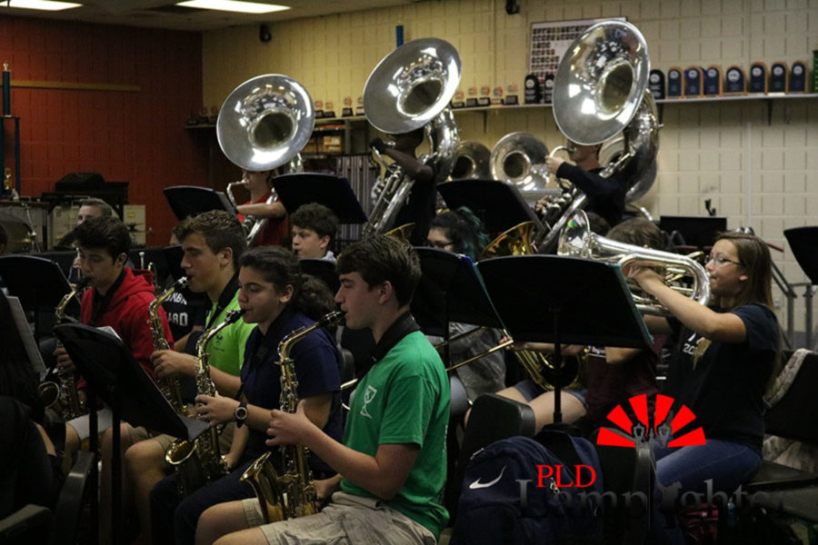 The woodwinds (front row) and the brass (back row).