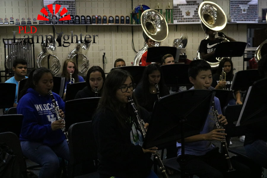 The clarinet section working on their music.