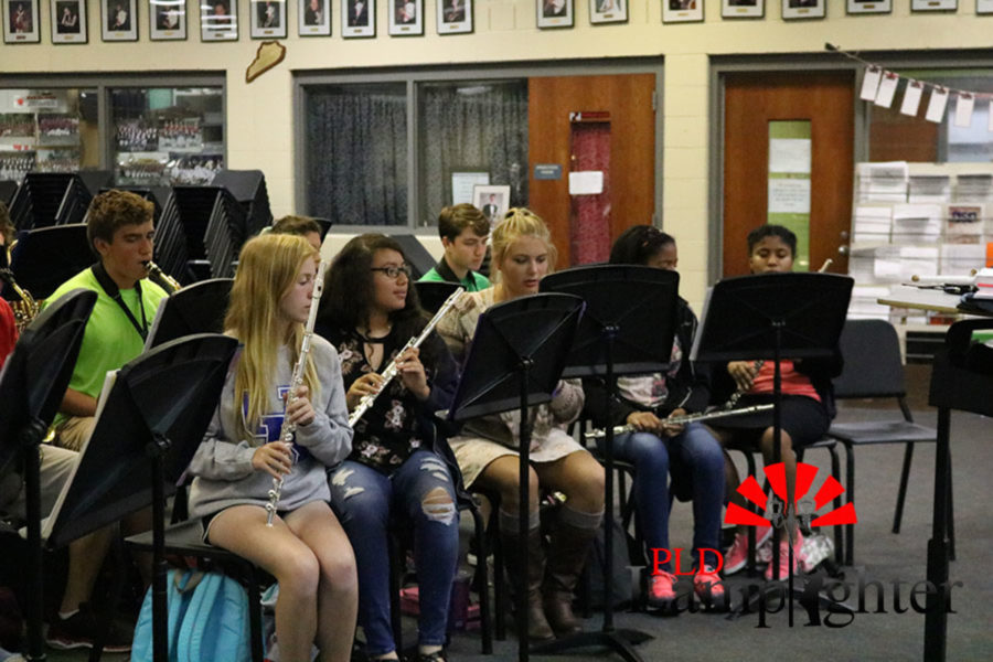 The flute section working on their music.
