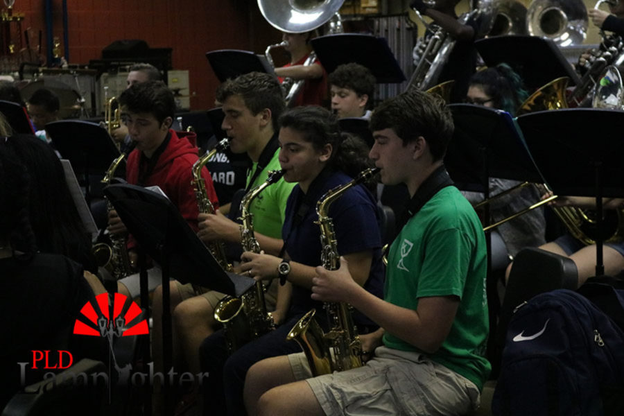 The saxophones playing one of their songs.