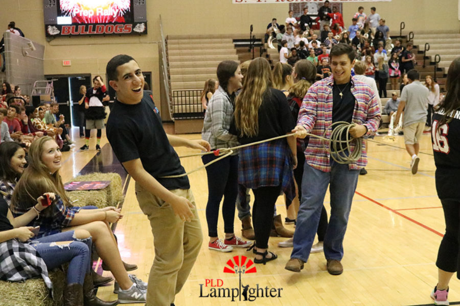 Senior Ramsey Amoudi executive gets all roped up in one of the senior class's props from their dance.