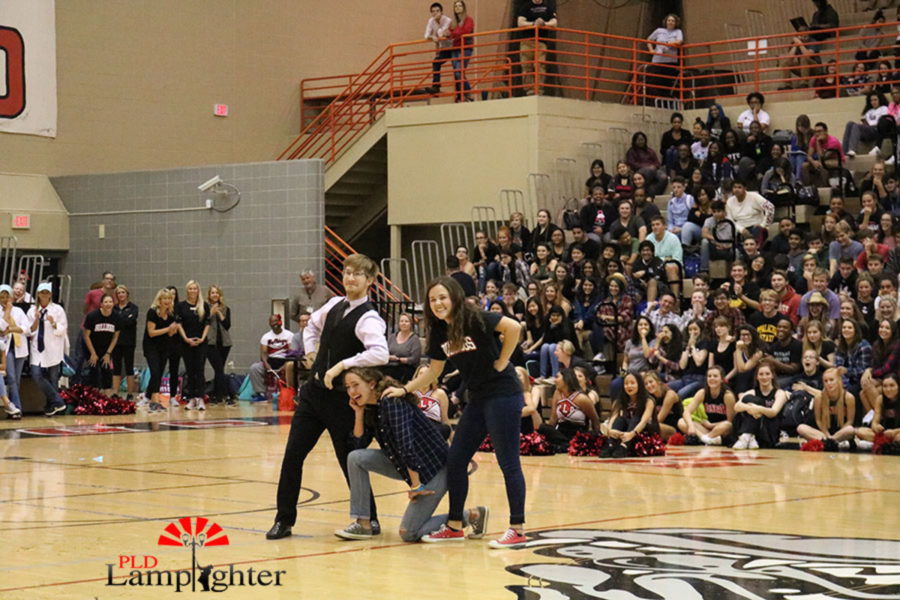The final three from the 2017 homecoming court involved in a game of Simon Says.