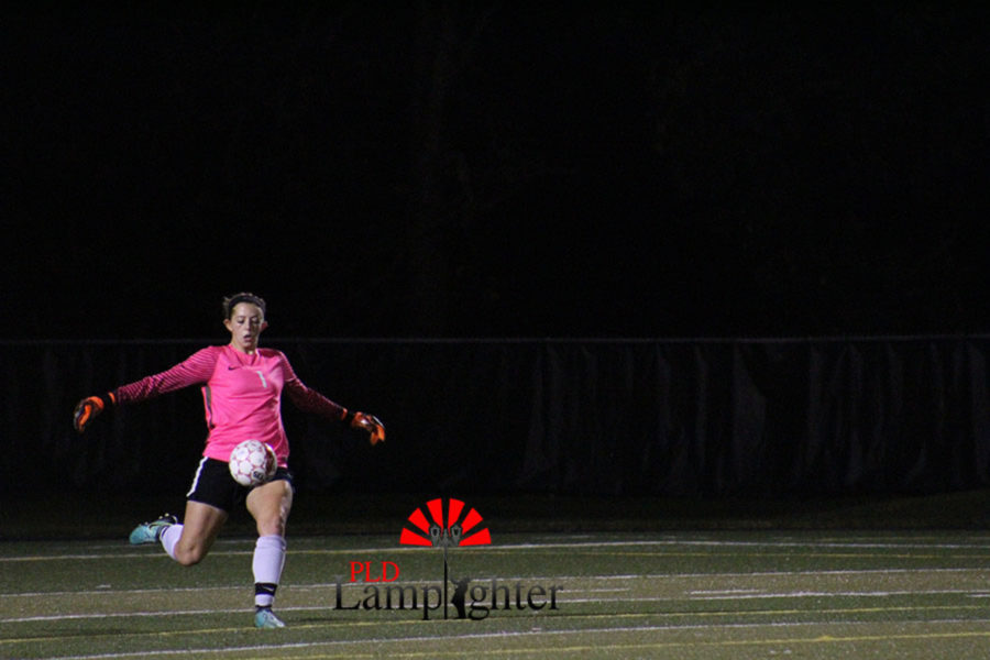 Goalie #1 Junior Morgan Turcotte deflects the ball from Dunbar's goal and kicks it back into the game.