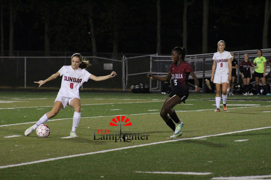 #8 Senior Sophia Mitchell dribbles the ball.
