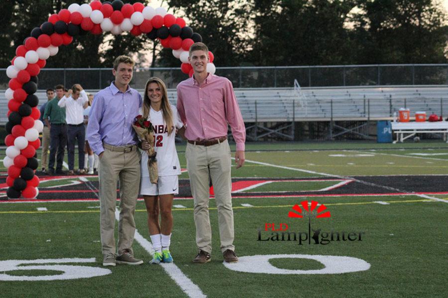 Senior Baylee Lanter escorted by Jake Heil (left) and Wesley Elliot (right).