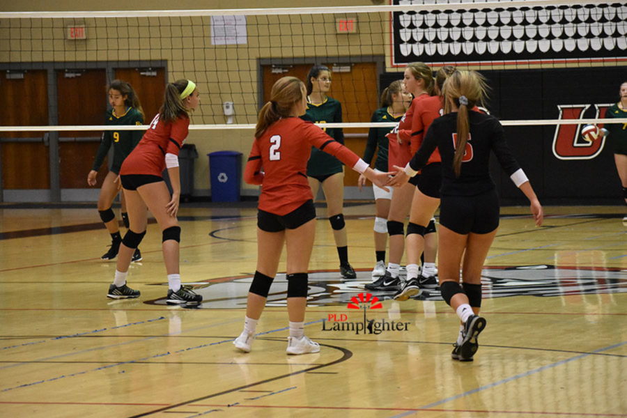 #2 Sophomore Lauren Spanyer reaches out a hand in support to #5 Senior Allie Chapman.