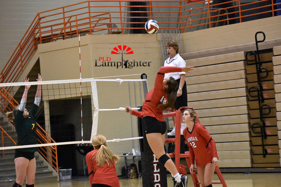 #10 Sophomore Peyton Gash sets up to swing the ball over the net.