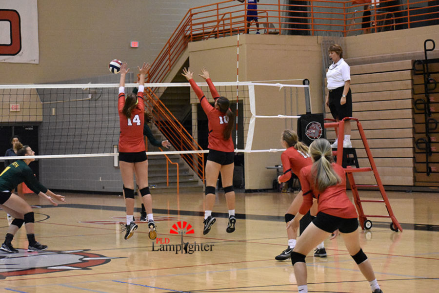 #14 Sophomore Eleanor Davis and #10 Sophomore Peyton Gash put up a strong block.