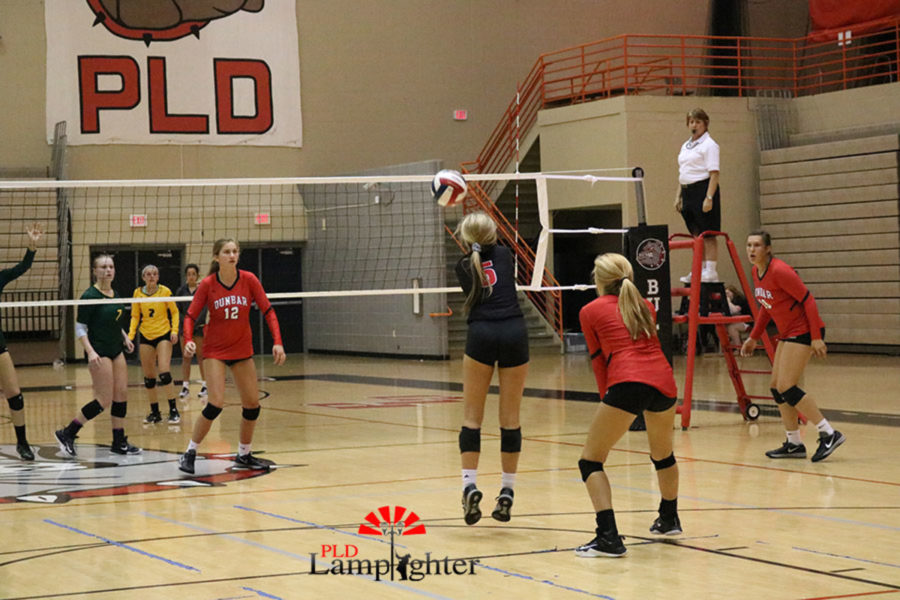 #5 Senior Allie Chapman launches the ball back over the net.