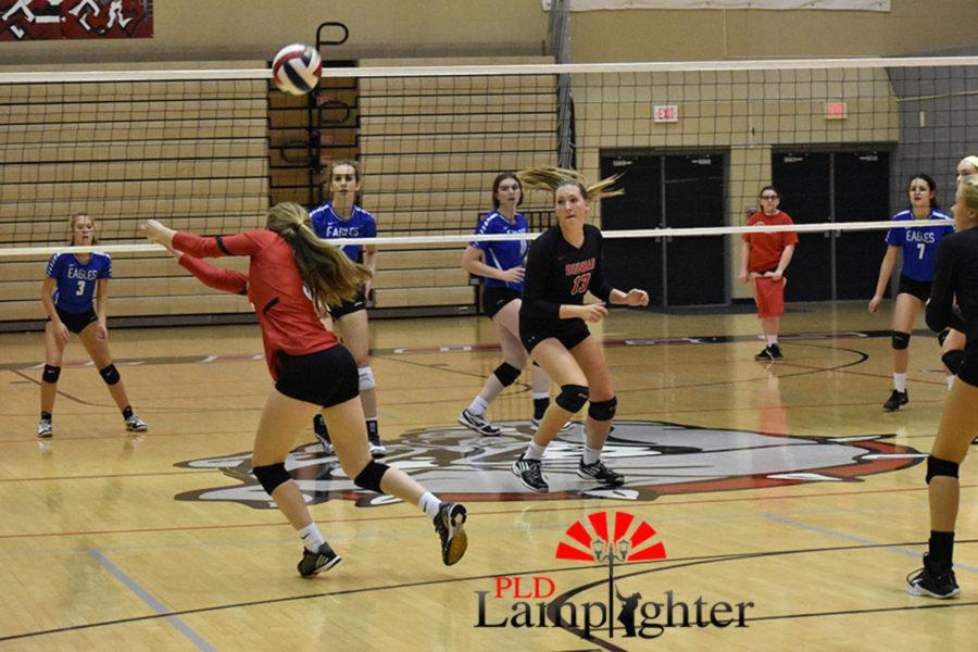 #3 Libero Caroline Cole pushes hard for a ball.