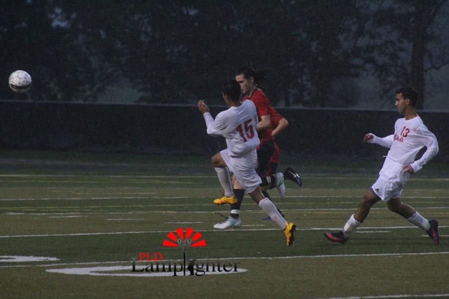 #15 Junior Crescenio Torres fights off an opposing player.