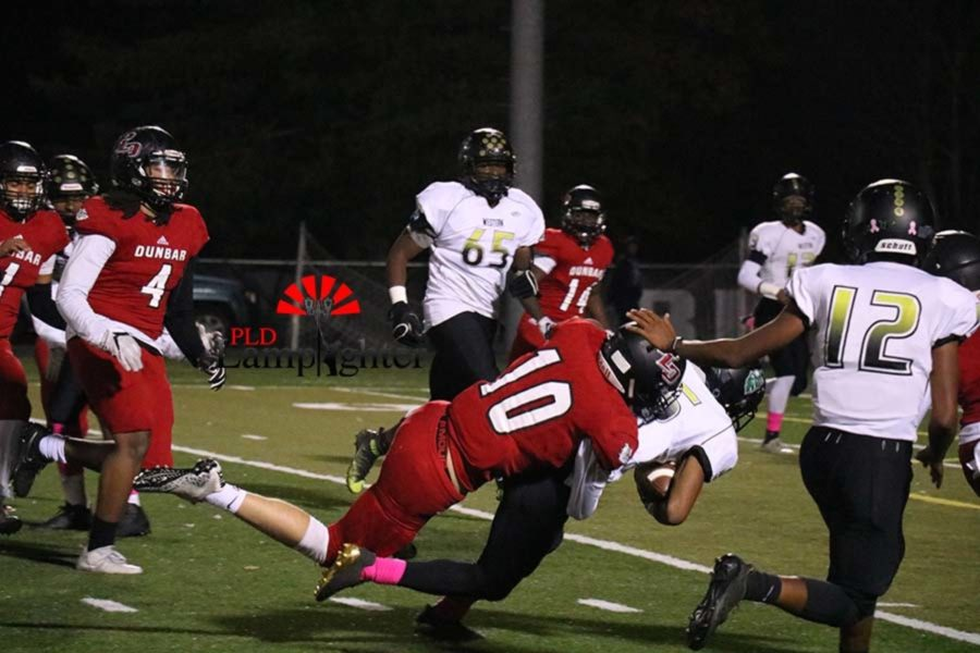 #10 Senior Cole Haney bringing down a player from behind.