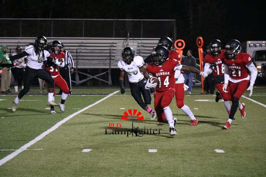 #14 Sophomore Mitchell Joseph returning a kick.