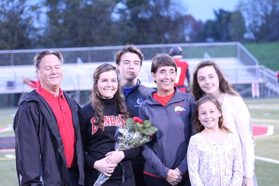Cheerleader Grace Koehler and her family.