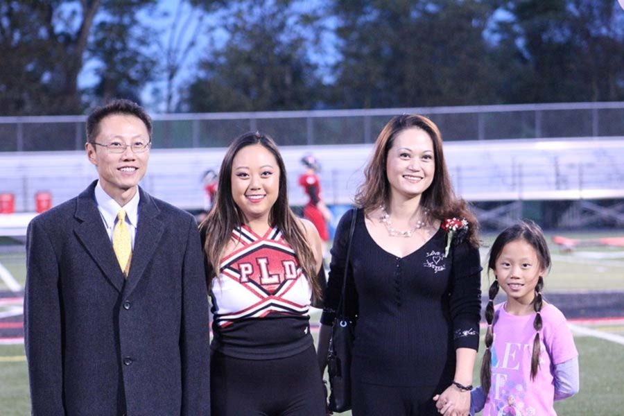 Senior Katherine Lin is recognized with her family on Senior night.