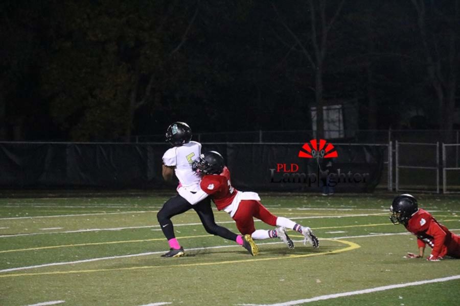 #3 Senior Kaden Gaylord making a tackle after opposing player makes a catch.