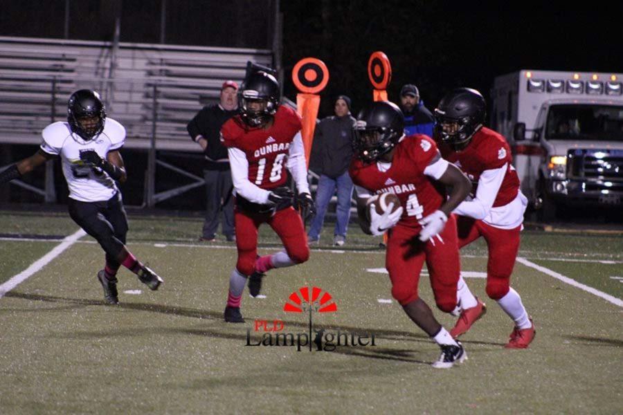 #14 Sophomore Mitchell Joseph runs ball down field.