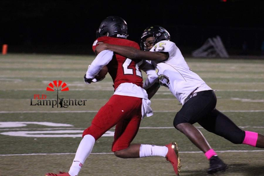 #22 Senior Darren Edmond avoids a tackle and carries the ball to the end zone.