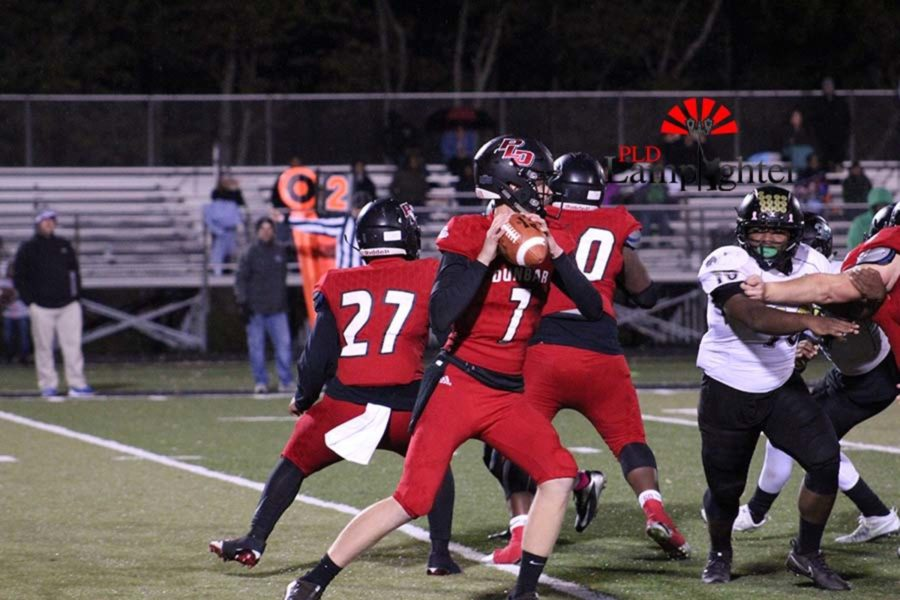 #7 Junior Tanner Cox ready to make a pass to an open teammate.