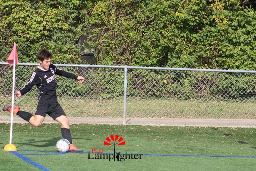 #5 Senior Jackson Akins performs a corner kick.