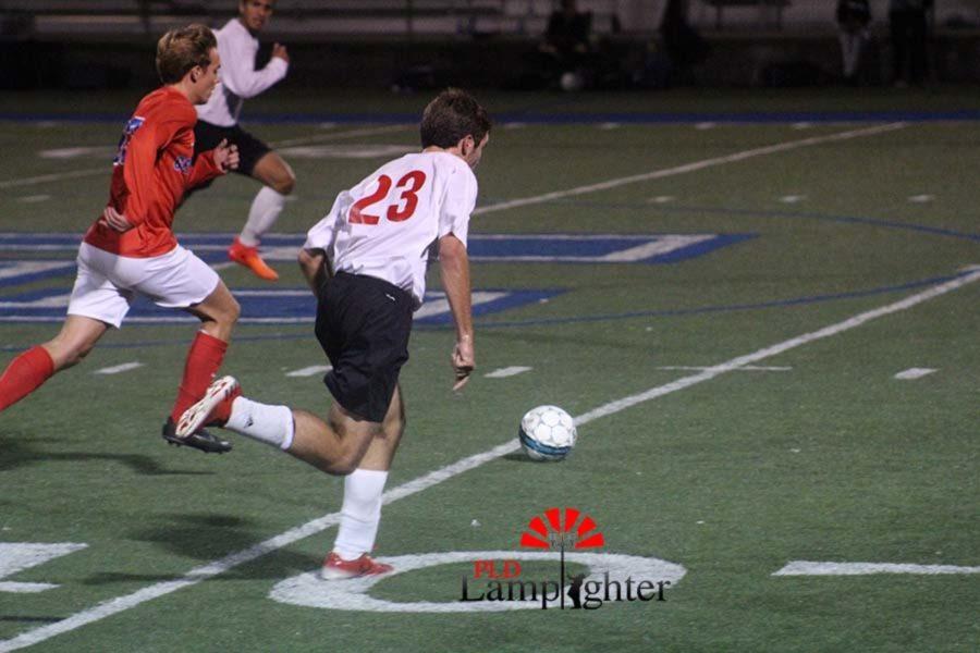 #23 Senior Nathan Williams preparing to steal the ball.
