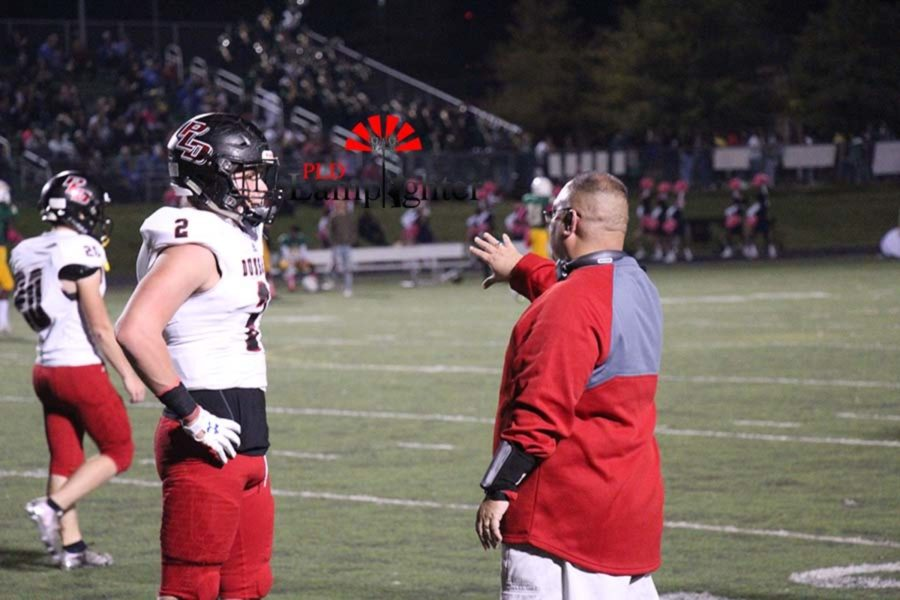 Coach gives #2 Tanner Wiley instructions on the play.