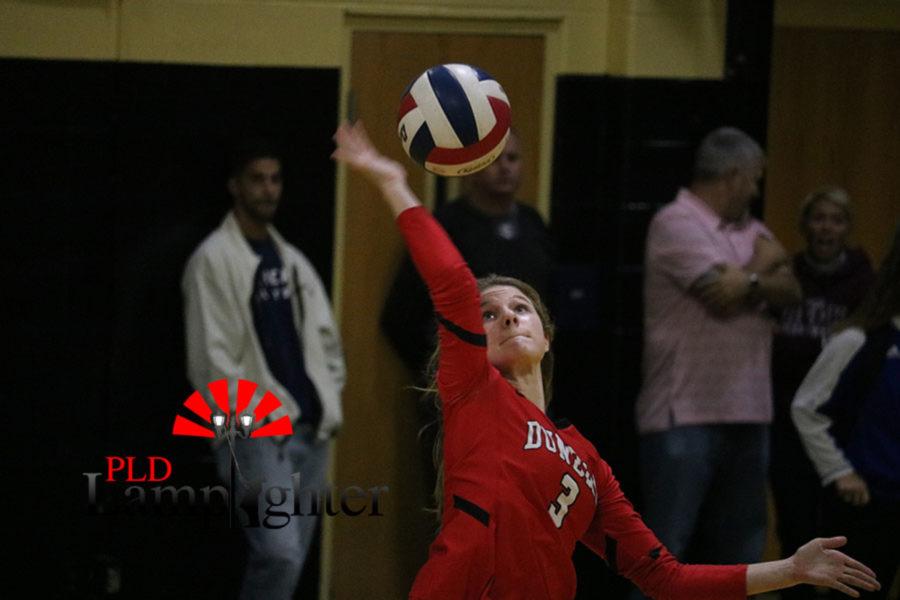 #3 Freshman Caroline Cole serving the ball for Dunbar.