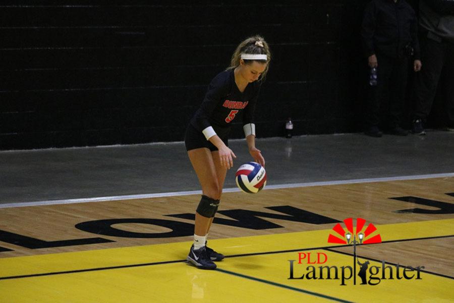 #5 Allie Chapman preparing to serve the ball.