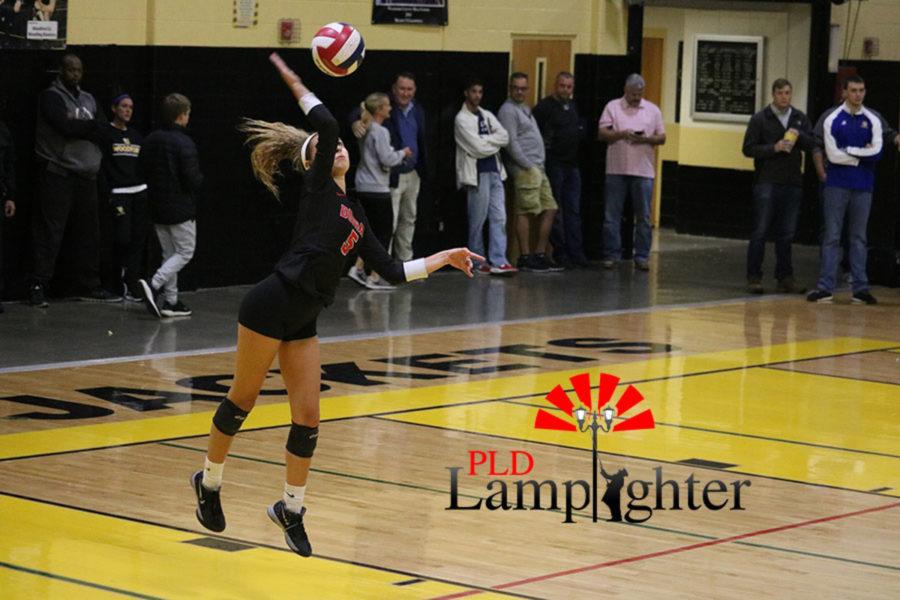 Allie Chapman serves the ball for Dunbar.